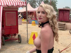 Busty blonde cutie Carly Lauren poses for the cam in a circus