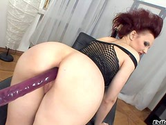 Bootylicious redhead babe with an amazing curved body enjoys in
