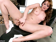 Brunette Sophie Moone fucking herself with sex toy