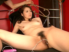 Arousing Japanese milf gets her hairy snatch poked with dildo