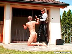 Collared man trampled by latex mistress