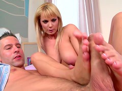 Beautiful blond with hot figure is giving unforgettable footjob