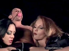 Gagged guy blown by two beautiful women