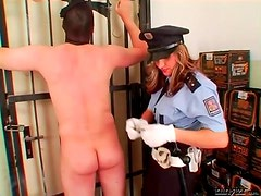Femdom cop flogs and canes the submissive guy