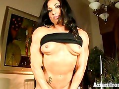Muscle woman pumps her big clit