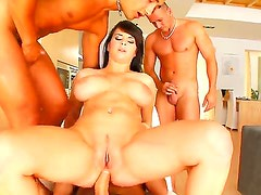 Busty babe named Kristi gets surrounded with cocks and