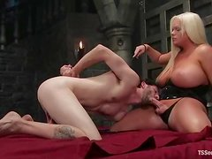 Blonde tranny with big boobs gives a titjob and fucks a guy