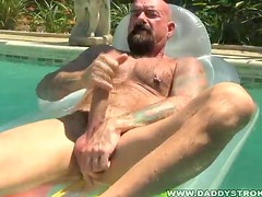 Bald Macho Daddy Jerks Off In Pool