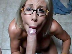 Blonde chick Puma Swede slurping her lover's huge cock in her slippery mouth