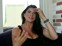 Busty brunette Romi Rain blows and titfucks and gets facialed