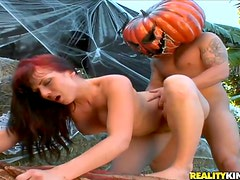 Redhead MILF Getting Fucked by Guy Wearing a Pumpkin on His Head