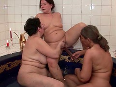 Old bitches  fuck each others cunts with dildo