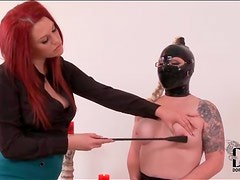 Latex hood is sexy on submissive young lady