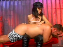 Brunette mistress is facesitting and spanking her slave