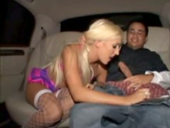 Skanky blond babe gives head to massive dick right inside the car