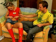 Sexy teen wearing red knee-high boots gives blowjob
