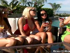 Four big tittied chicks have sex with a guy by the pool