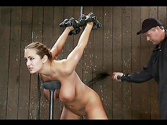 Spanking Trina Michaels' butt cheeks and toying her pussy in BDSM vid
