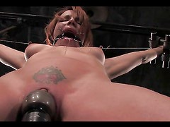 Horny redhea'd has her nipples tortured as she's tied up