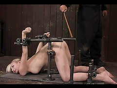 Ashley Jane immobilized in doggy position for anal toying in BDSM