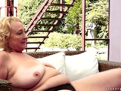 Fat blonde granny plays lesbian games with a cute brunette near a pool