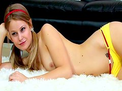 Pigtailed goddess is lying on the carpet