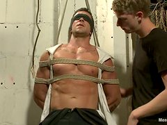 Trenton Ducati gets his dick sucked and rubbed in a hot BDSM scene