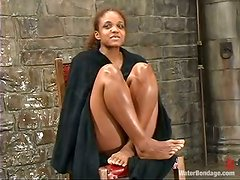 Sinnamon Love enjoys cold water on her body in a kinky BDSm vid