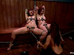 Two brunette chicks get tied up and toyed at a bar