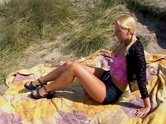 Appetizing blonde girl with petite sexy body wanks in the open air