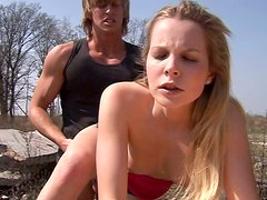 Long legged blond haired teen in pink top rides a dude's dick on the rocks