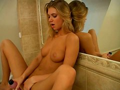 Bootylicious cock hardening teen Megan mastrubates with a dildo near the mirror