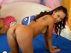 Beautyful babe Victoria plays with her coochie on a bed using smooth dildo