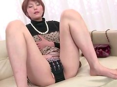 Classy Japanese housewife fingers pussy