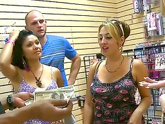 Three lovely chicks are exploring a neat sex shop. They are browsing through various