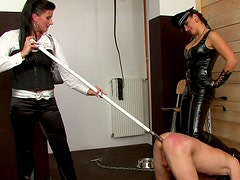 Leather mistress abuses the slave