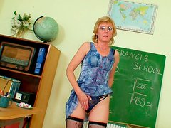 Kinky teacher Zlata  in stockings pleases her pussy with fingers and dildo toy