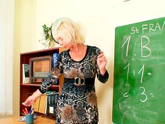 Kinky teacher Lukava pleases her snatch in the staffroom