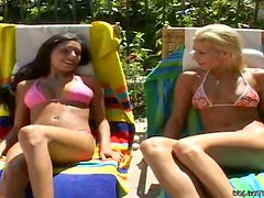 Two pretty girls practise scissoring and play with a strapon