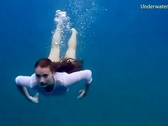 Chick gets naked swimming in the ocean