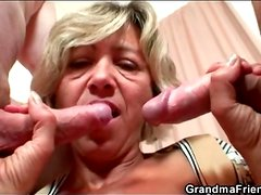 Old lady in bathrobe strokes younger cocks