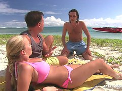 Busty Jessica Moore gets double penetrated on a beach