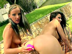 Sweet lesbian cuties Peaches and Clara G. are having kinky anal fun outdoors. One of