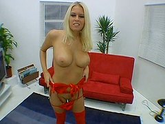 Big breasted blonde sexpot gives her lover a great blowjob