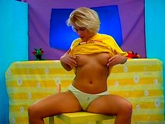 Juicy blonde with plump tits stimulates her big clit