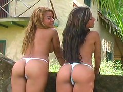 Tanned twins with juicy asses are posing!