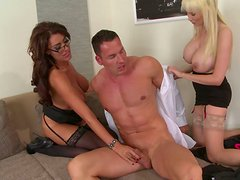 Busty colleagues share one lucky dude in threesome
