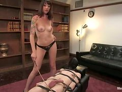 Lexi Bardot rides her boss, having him tied up and twitched