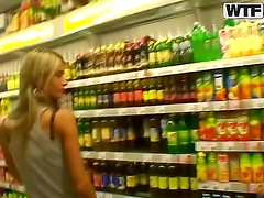 Slim blonde chick Nessa Devil strolls trhough a store while her lover is recording her