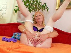 Nasty blonde momma shows off her pink juicy vag